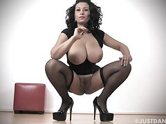 Busty MILF Danica Collins in stockings and uppity heels playing