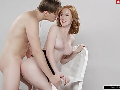 Redhead shakes them tits like a bawd while riding the heavy dong