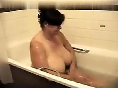 Brunette tyro showing hot boobs in the shower